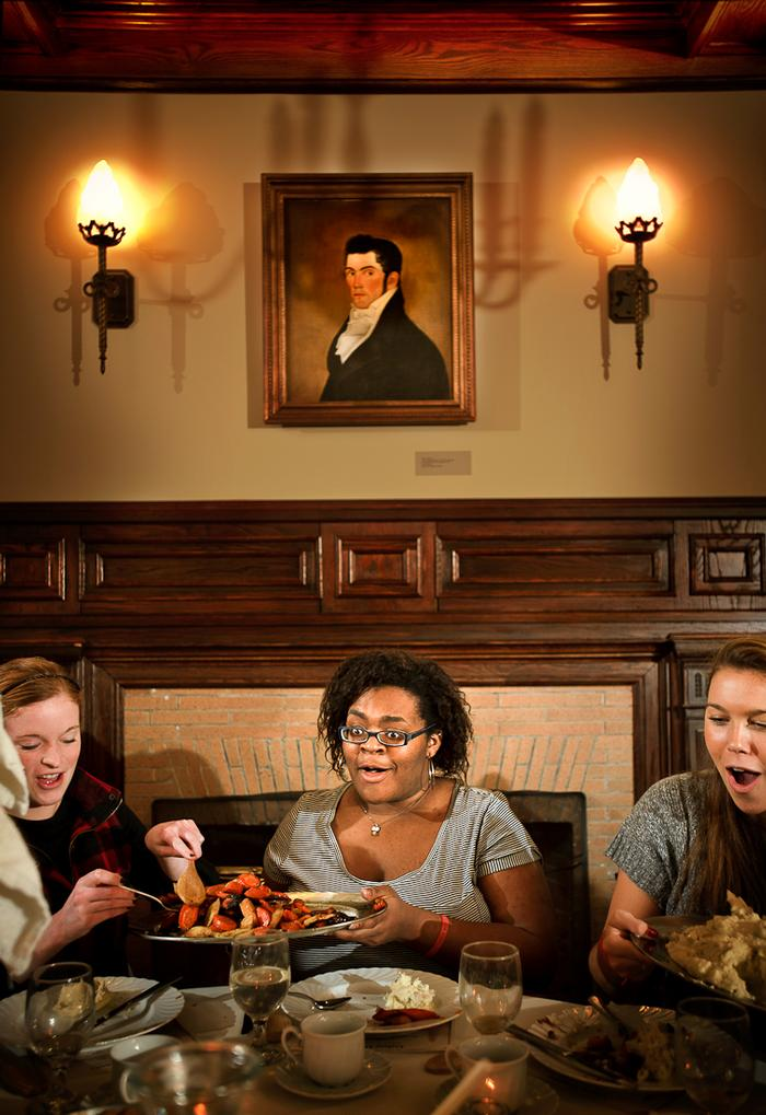 Nanyamka Fleming '13 , center, reacts to all the food being brought out. PHOTO: BY NANCY FORD