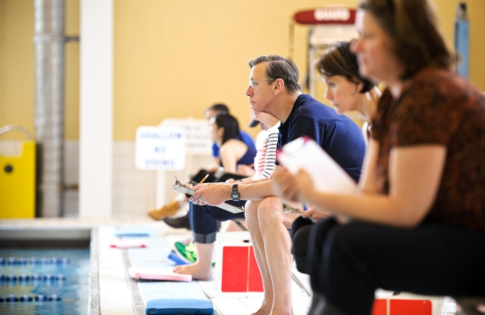 Time keepers count laps for swimmers in Bristol Pool.  PHOTO: NANCY FORD