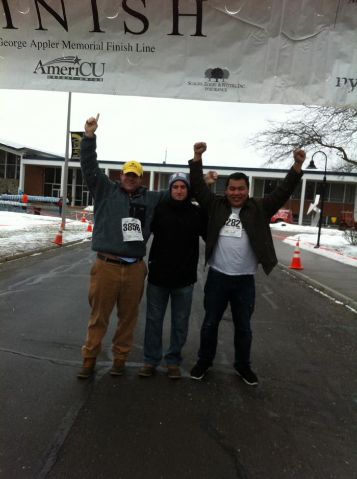 Charlie Bueneman, Chris Jusuf, and Eric Boole cross the finish line for Psi U.