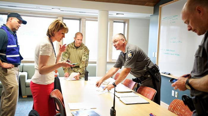 Meredith Harper Bonham, Senior Associate Dean of Students, works with NY State Police to gather as much information about the assailant as possible. PHOTO: REBECCA SHEETS