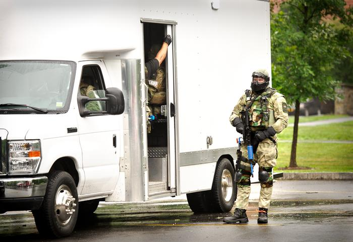 Members of the Oneida County Sheriff Department SWAT team arrive at the scene. PHOTO: REBECCA SHEETS