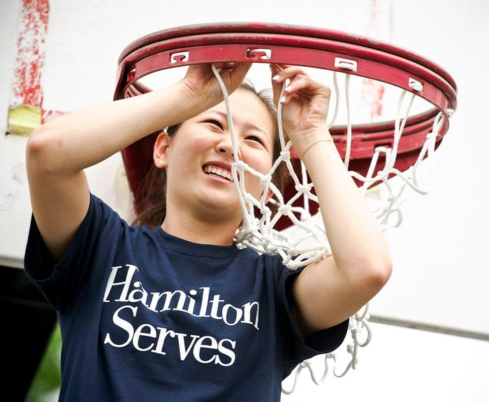 Jane Lee '16 changes the net on a basket ball hoop at the Johnson Park Center. PHOTO: NANCY L. FORD