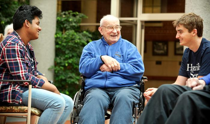 Saiyan Hossain '18 and Ian Baize, right, chat with Harold Luley at the Masonic Home. PHOTO: NANCY L. FORD