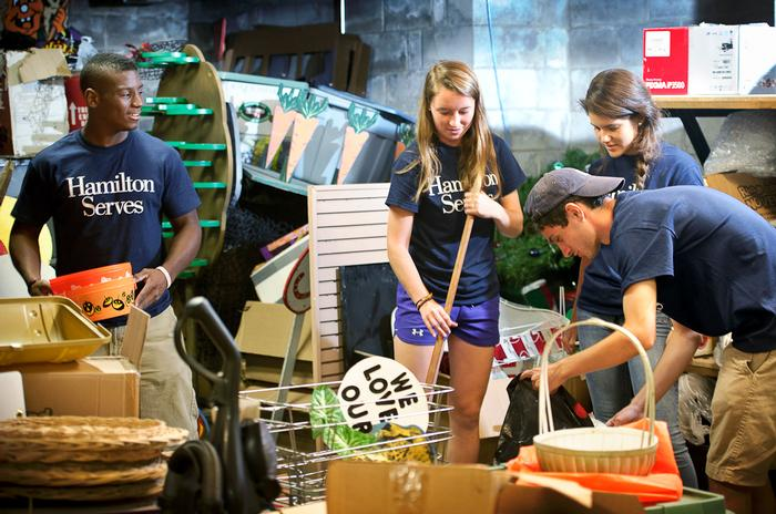 Marcus Gutierrez '18, Katja Dunlap '18, Mariaelena Hiller Chacin and Aaron Channon help organize a storage room at the Utica Zoo.  PHOTO: NANCY L. FORD