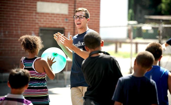 Connor Reese '17 leads a game at The Neighborhood Center. PHOTO: BY NANCY L. FORD