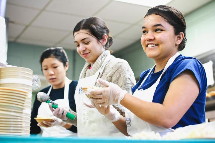 From left, Linda Yu '12, Salome Kuchukhidze '14 and Barsha Baral '13 dish out macaroni salad at the Rescue Mission. PHOTO: BY NANCY FORD
