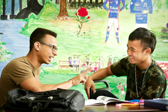 Levitt research group member Gabriel Rivas '16, left,  talks with Ku Say at the Mohawk Valley Refugee Center. PHOTO: NANCY L. FORD