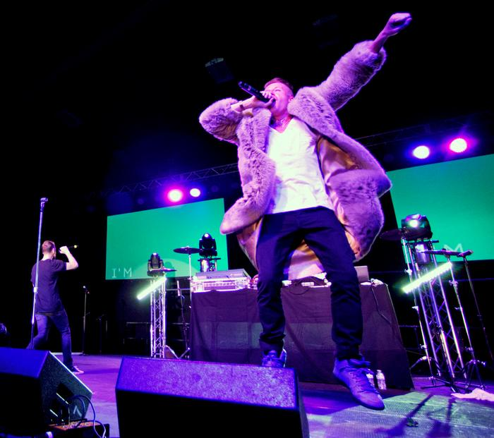 Macklemore borrowed a student's fur coat before performing<em>Thrift Shop</em>. PHOTO: BY MEGAN HAMAN