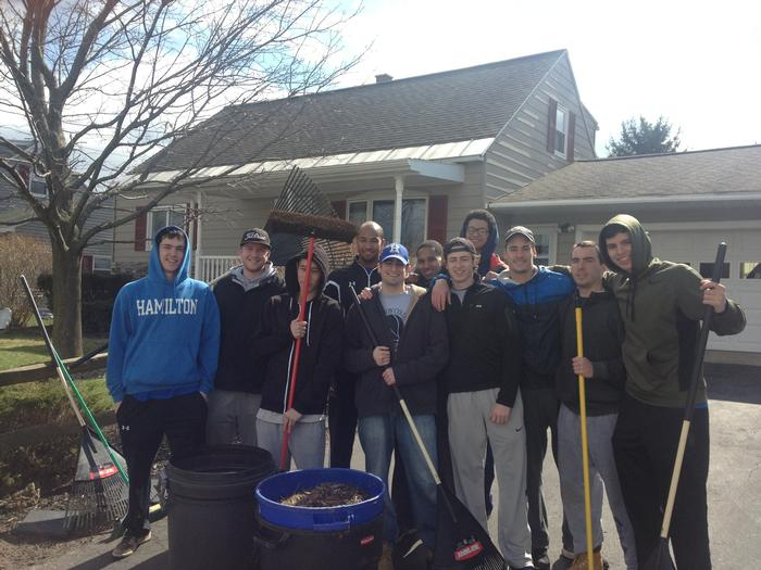 Members of the men's basketball team helped clean some senior citizens' yards in New York Mills on April 20.