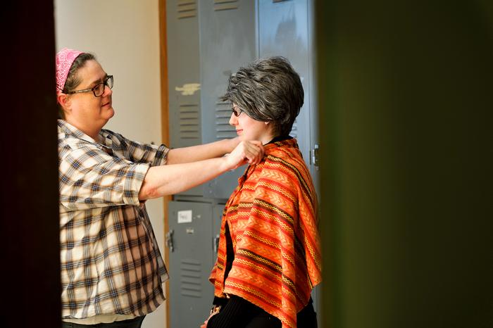 Kelsey Crane '17, gets her outfit adjusted by costume designer Amy Petta.  PHOTO: NANCY L. FORD