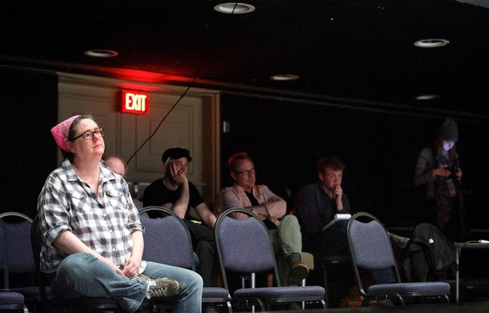 Costume designer Amy Petta, Director Craig Latrell and other crew members watch a rehearsal for the last production at Minor Theater. PHOTO: NANCY FORD