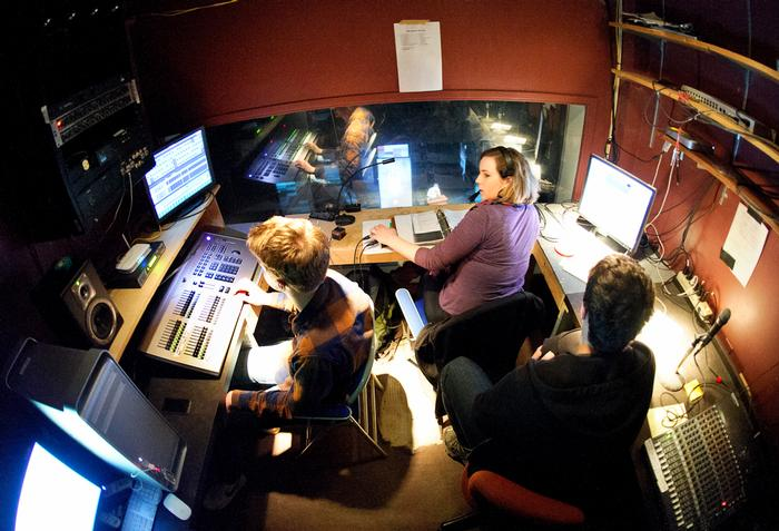 Eliza Burwell '17, runs the lighting and projector booth that overlooks the stage. PHOTO: NANCY FORD