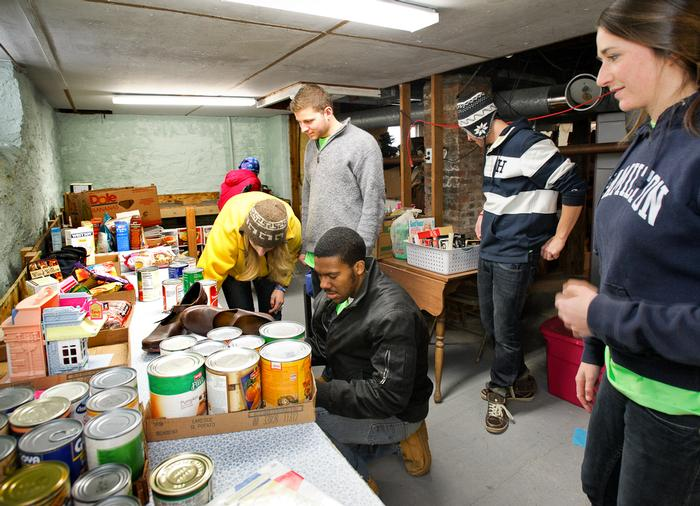 Standing, l-r, Nina Byers' 16, Andrew Gibeley '16, T.C. Topp '16, Jane Barnard '13 and kneeling, Leonard Collins '15, volunteered at the Country Pantry.  PHOTO: BY NANCY L. FORD