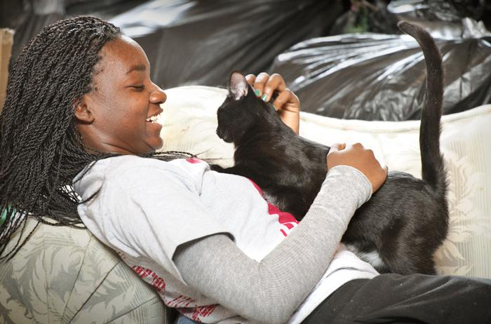 Jorett Joseph '15 and friend at Spring Farm Cares in Clinton. PHOTO: BY NANCY FORD