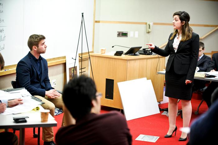 Prosecutor Samantha Fidler (Cornell University) tries to break defendant, Ian Carradine '15. PHOTO: NANCY FORD