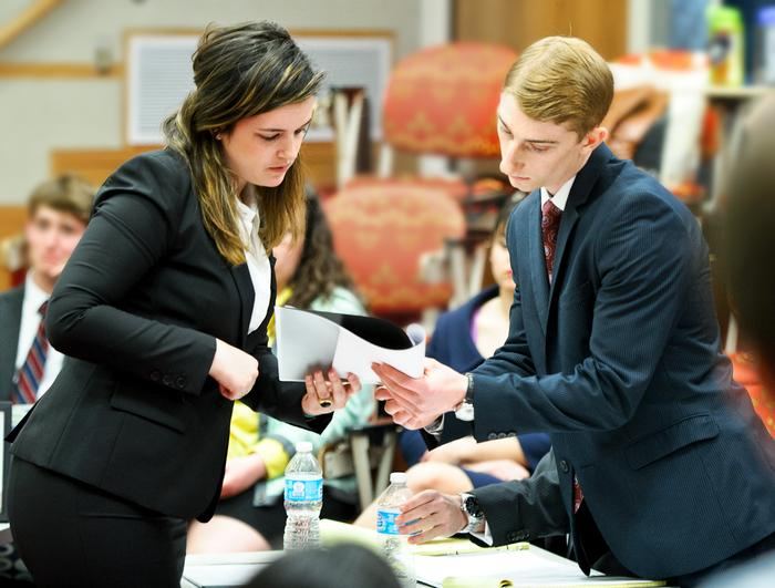 Prosecutor Samantha Fidler (Cornell) confers with defense attorney Jason Driscoll '14. PHOTO: NANCY FORD