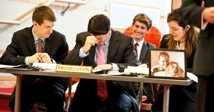 "The Cornell University Prosecution table tries to remain composed as a ""colorful"" witness gives testimony during the mock trial. From left, Aaron Mallenbaum, Alec Diamond and Samantha Fidler. PHOTO: NANCY FORD"