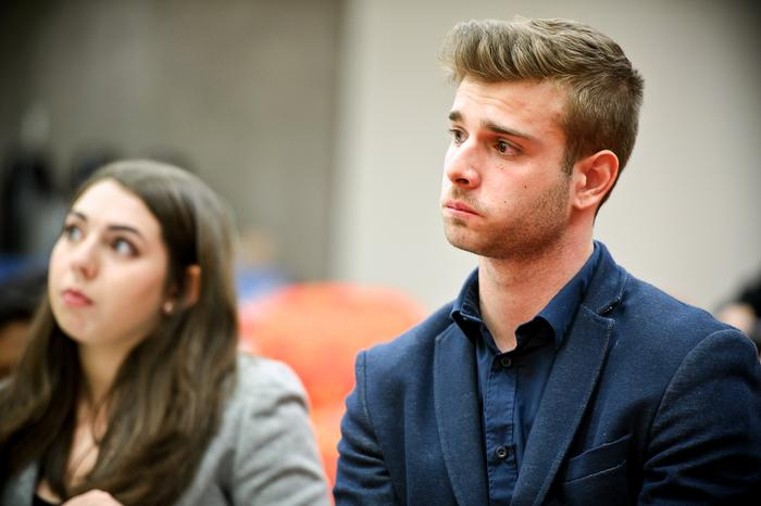 A very glum defendant, Ian Carradine '15, listens to testimony that accuses him of causing the death of a police officer during the mock trial. PHOTO: NANCY FORD