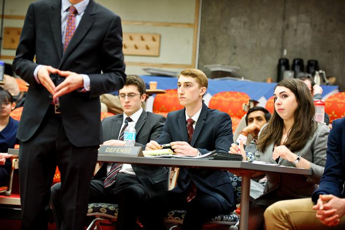 The defense table listens to prosecutors cross examine a witness. From left, Will Walant '17, Jason Driscoll '14 and Caroline Reppert '17. PHOTO: NANCY FORD