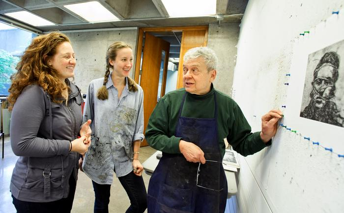 Professor of Art Bruce Muirhead talks with Danielle Lashley '13, left, and his assistant, Emily Archer '13, center, about Lashley's print. PHOTO: BY NANCY FORD