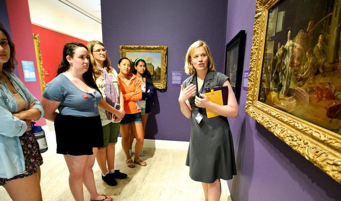 Museum Education Coordinator Clare Fitzgerald  describes a painting at MWPAI. PHOTO: NANCY L. FORD