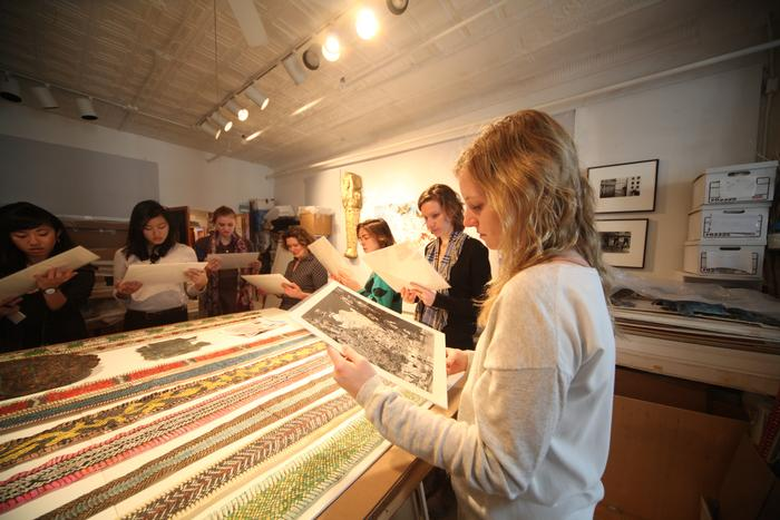 Students examine prints in the studio of Jane Hammond. PHOTO: BY SUMAN SARKER '11