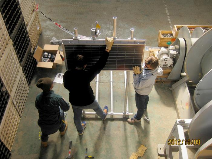 Garrett Akie '12, Katy Smith '13 and Deanna Nappi '15 assembling the aluminum frame of the cGPS station that will be installed at Spring Point.