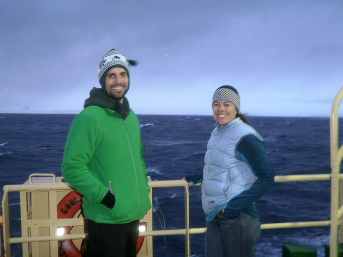 Geology professors Brad Rosenheim (Tulane Univ.) and Amelia Shevenell '96 (Univ. of South Florida) pose in front of icebergs on the deck of the Laurence M. Gould.