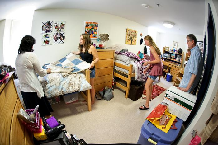 Rachel Pollan '16 makes her bed as Charlotte Beers '16 straightens up in their North Hall room on Aug. 25.  PHOTO: BY NANCY FORD