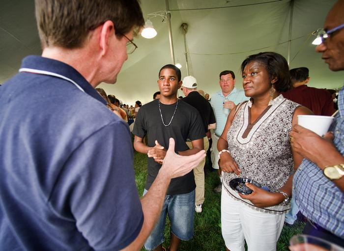Biology Professor Mike McCormick talks with Arthur Williams '16 and his mom, Elaine during the President's reception on Dunham Green.  PHOTO: BY NANCY FORD
