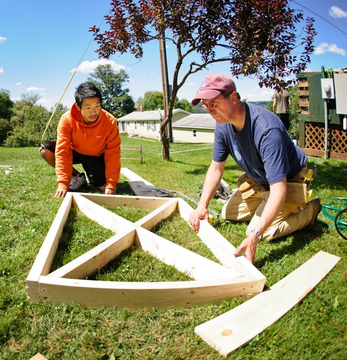 Risheng Zeng '16, left, works with Rebuild Mohawk Valley project manager Chip Hemmel on building a gate during OA. PHOTO: BY NANCY FORD