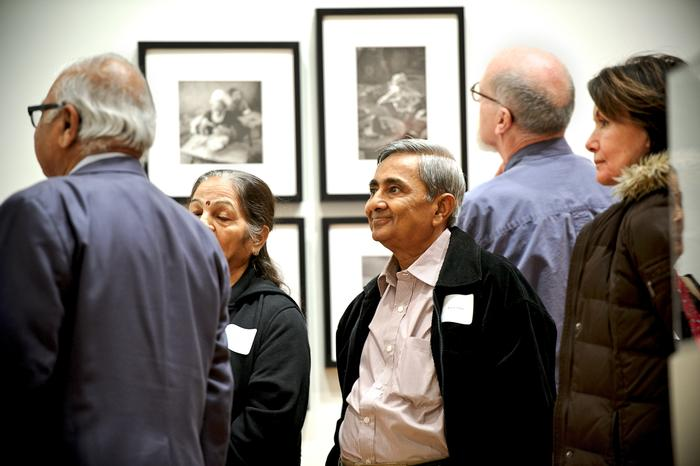 Anand Patel, son of Pranlal Patel, smiles as he sees a photograph he took of his father. PHOTO: NANCY FORD