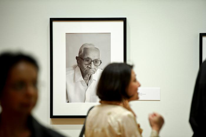 A photograph of Pranlal K. Patel appears to have a watchful eye over guests during a reception at the Wellin Museum. PHOTO: NANCY FORD