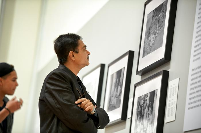 Gautam Patel, grandson of Panlal Patel, looks at the Wellin exhibit.  PHOTO: NANCY FORD