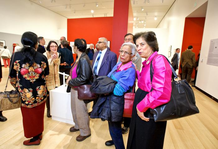 "Guests check out the photographs during a reception for the exhibit, ""Refocusing the Lens: Pranlal K. Patel's Photographs of Women at Work in Ahmedabad"" in the Wellin Museum.  PHOTO: NANCY L. FORD"