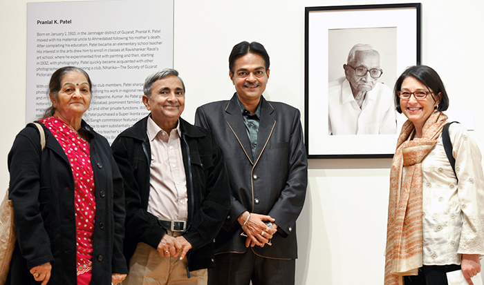 Anand Patel, with his wife Jaya, left, and son Gautam, right, pose with Lisa Trivedi and a portrait of Pranlal Pratel, whose work is on exhibit at the Wellin Museum of Art. PHOTO: NANCY L. FORD