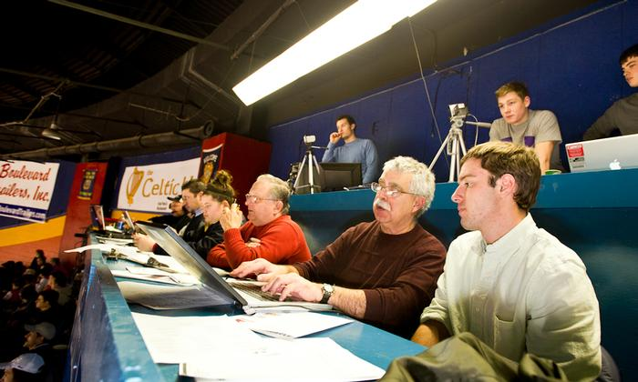 As part of his shadowing day Greg Scott '14  covered a hockey game with Utica <em>Observer-Dispatch</em> reporter John Pitarresi '70 PHOTO: BY NANCY FORD