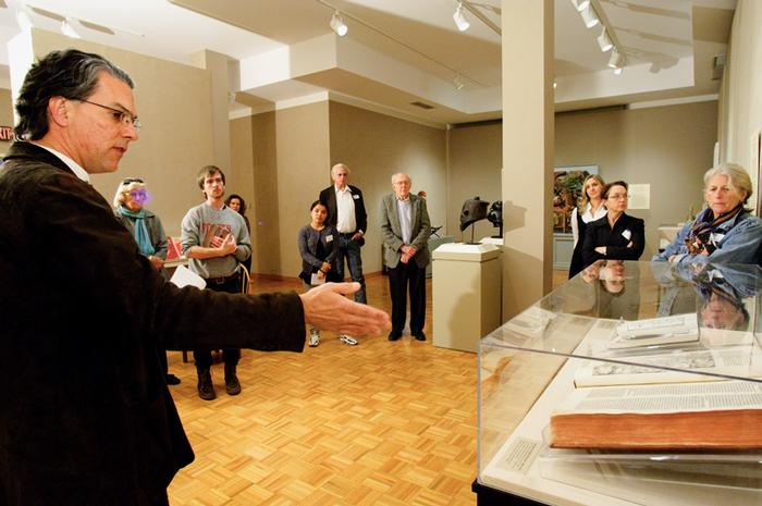 Brent Plate gave a talk in the Emerson Gallery about the religious art exhibit. PHOTO: BY NANCY FORD