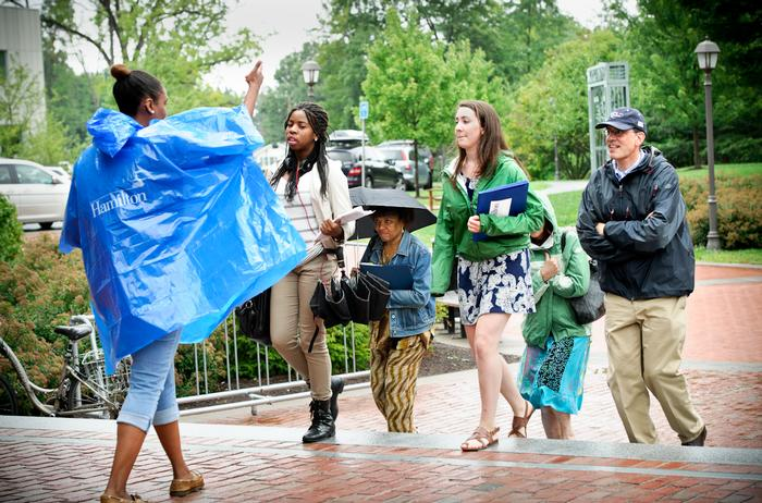 Dodging the rain, a member of the Class of '18 and her family tour campus. PHOTO: REBECCA SHEETS