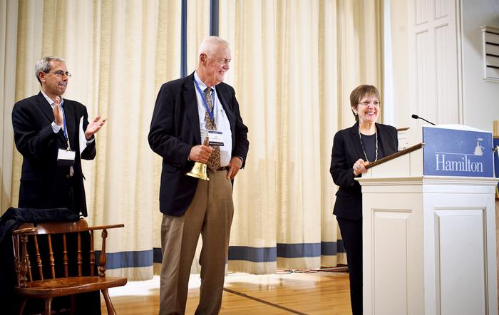 President Joan Hinde Stewart recognizes Bell Ringer honoree William Braunlich '57, center. PHOTO: BY NANCY L. FORD