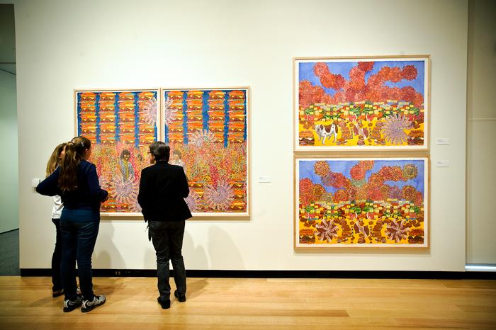 Visitors check out the Faculty Art Show at the Wellin Museum of Art. PHOTO: BY NANCY L. FORD