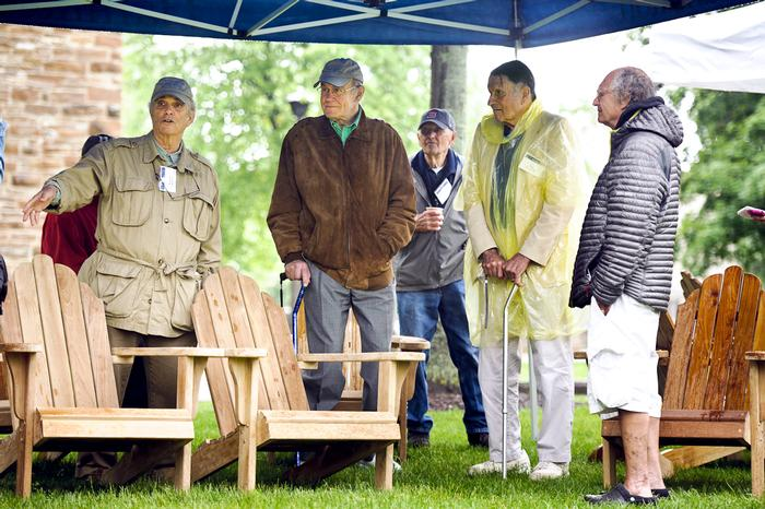 Alumni tell stories about the people honored during an Adirondack Chair Dedication ceremony on the lawn in front of Carnegie Hall. PHOTO: BY NANCY L. FORD