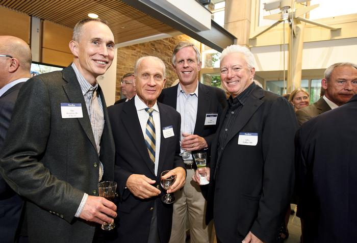 A.G. Lafley '69, right, poses with other alumni in the Taylor Science Center. Lafley was honored as outgoing board chair.  PHOTO: BY NANCY L. FORD