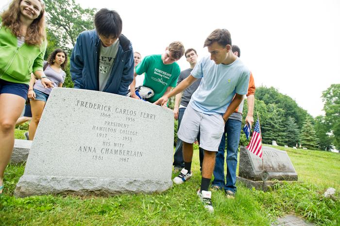 On the Scavenger Hunt, students find the grave marker of Hamilton president Frederick Ferry in the College cemetery PHOTO: BY NANCY FORD