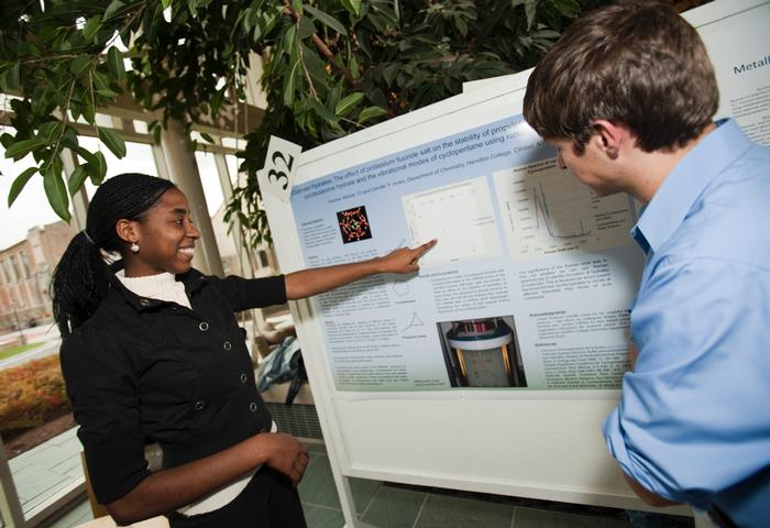Students displayed their science posters in the atrium. PHOTO: BY LAURA C. LAUREY