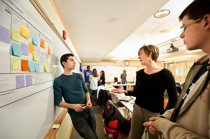 Michael Nelson '16 left, and Alexandru Hirsu '17 speak with Anke Wessels, of Cornell University, center, as they work on a project together during the Levitt Social Innovation Fellows Program. PHOTO: BY NANCY L. FORD