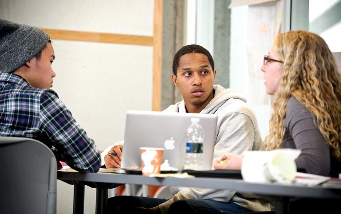 Thomas Figueroa '15, center, works with Ryan Ong '16, left, and Lily Wasser '16, at the workshop. PHOTO: BY NANCY L. FORD