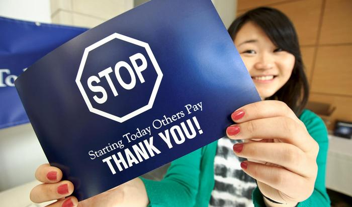 Yeun Jae Song '16 shows Stop Day thank you card in the Taylor Science Center atrium. PHOTO: NANCY FORD