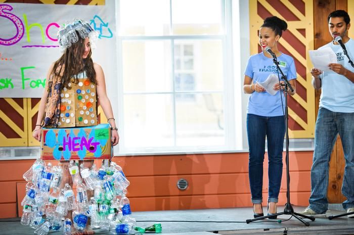 Hannah Trautmann '15 models her outfit designed by HEAG and made out of bottles and bottle caps. PHOTO: NANCY L. FORD