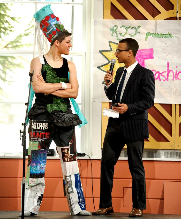 Ben Goldman '17 has a conversation about his design with emcee Gabriel Rivas '16. PHOTO: NANCY FORD